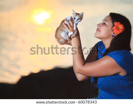 Woman with kitten outdoor at sunrise time