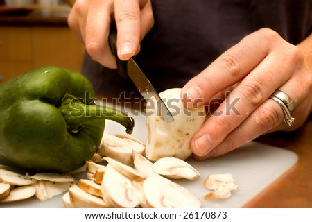 woman with knife cooking