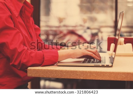 Woman with laptop in cafe shop #321806423