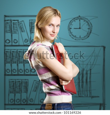 Woman with laptop in her hands, looking on camera - stock photo