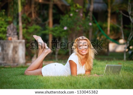 woman with laptop on the grass