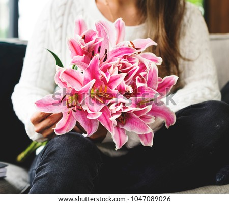 Woman with lily flower bouquet #1047089026