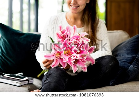 Woman with lily flower bouquet