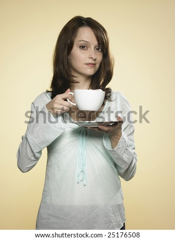 woman with long brown hair and a cup of coffee 03