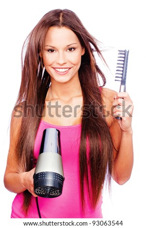 woman with long hair holding blow dryer and comb, isolated on white