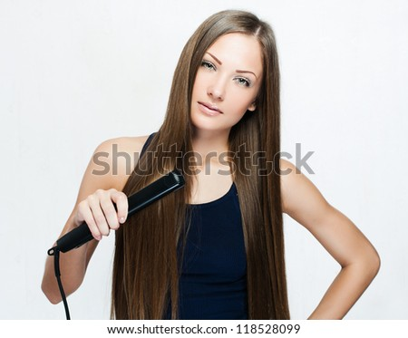 woman with long hair , makes styling hair