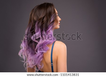 Woman with Long Healthy Colorful Ombre Lavender Wavy Hair. Close Up of Hairstyle. Care and Hair Products
