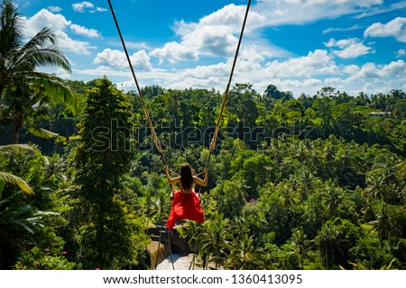 woman with long swing and forest view ストックフォト ©