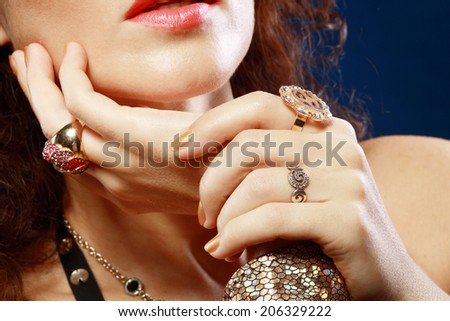 Woman with luxury jewelry hands close up