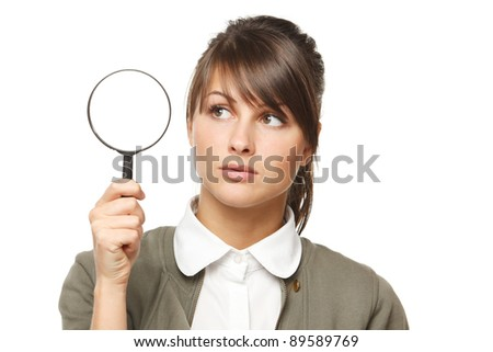 Woman with magnifying glass over white background