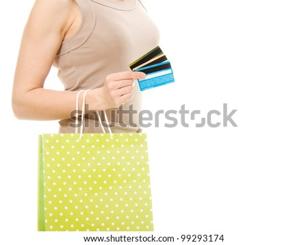 Woman with many different credit cards and shopping. Isolated on white.