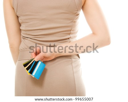 Woman with many different credit cards behind his back.