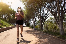 woman with mask running in the