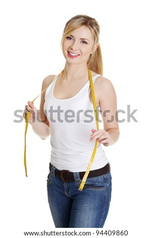 Woman with measuring tape , isolated on white