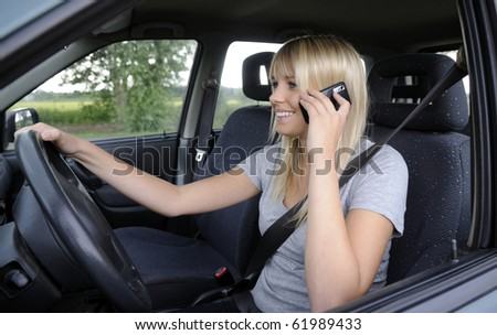 woman with mobile phone in the car
