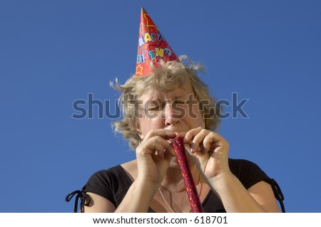 woman with noisemaker