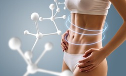 Woman with perfect body near big molecule chain. Slimming concept. Improvement of metabolism concept.