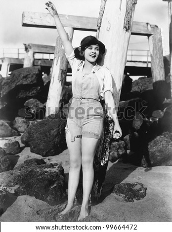 Woman with pilings at beach - stock photo