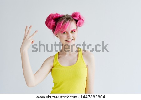 woman with pink hair is smiling on a light background #1447883804
