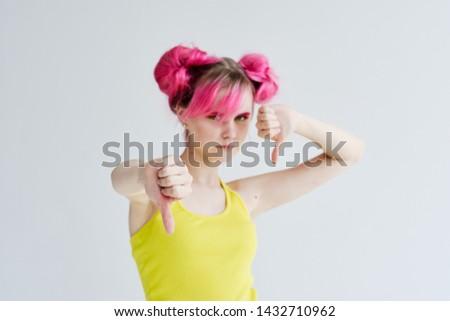 woman with pink hair sad thumb down signs #1432710962