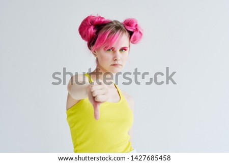 woman with pink hair. serious portrait #1427685458