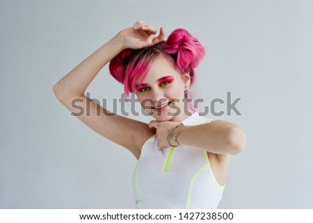 woman with pink hair smiling makeup #1427238500