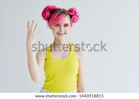 woman with pink hair smiling signs #1440918815