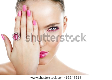 Woman with pink makeup. Focus on eye. Space for text.