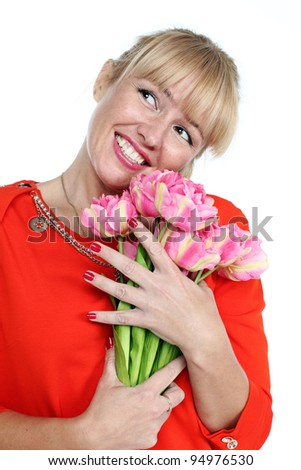 Woman with pink tulips bouquet of flowers smiling isolated on white background
