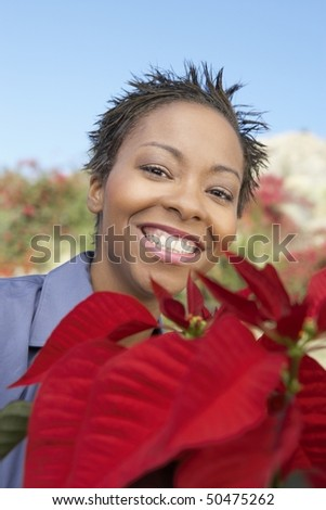Woman with Poinsettia, (close-up), (portrait)