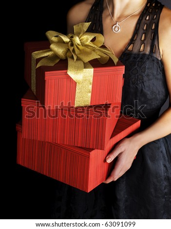 Woman with presents on black background