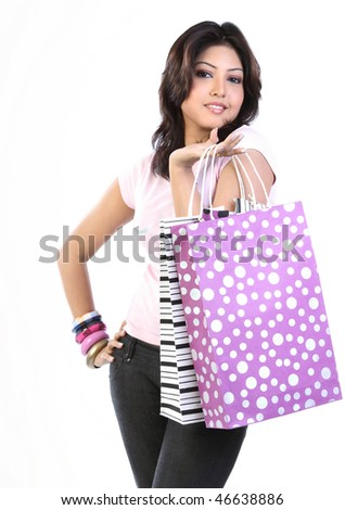 Woman with purple color shopping bag