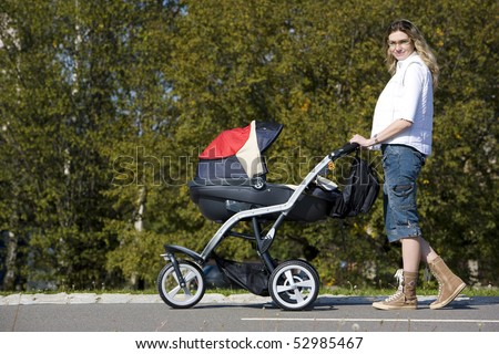 woman with pushing a pram