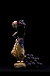 Woman with raisins from pebble