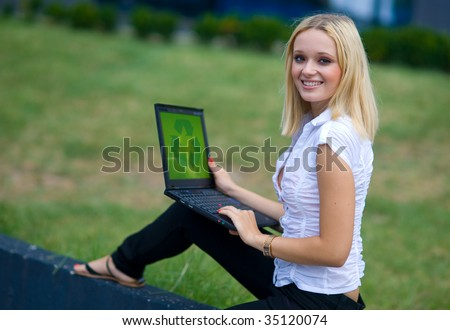 woman with recycle sign on computer
