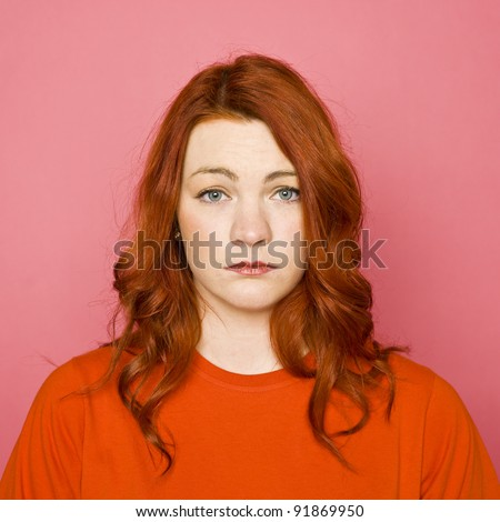 Woman with red hair on pink background