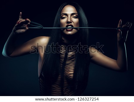 woman with red lips biting whip