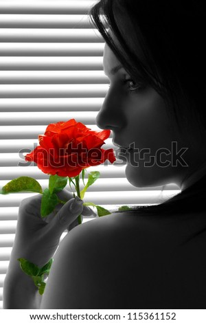 Woman with red rose - portrait
