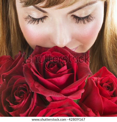 Woman with red roses - stock photo