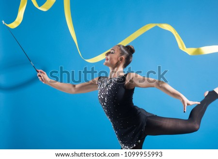 Woman with ribbon for rhythmic gymnastic. Workout sports activities in gym of flexible girl. Sport success and health. Woman train acrobatics with ribbon. Fitness and dieting of girl gymnast.