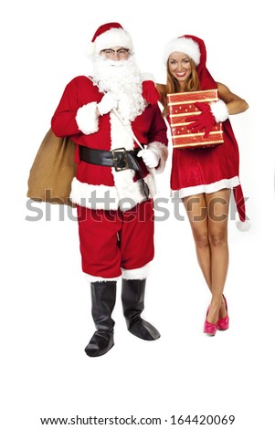 woman with santa claus holding a gift