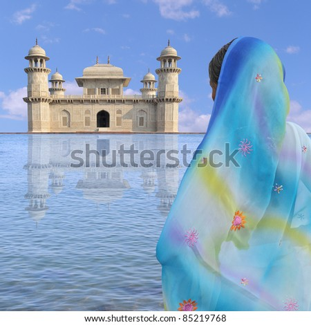 Woman with sari near a palace in India.