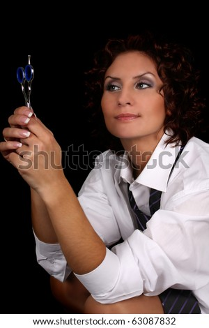 woman with scissors isolated over black background
