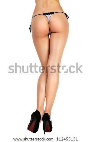 Woman with sexy legs in the black shoes. Model on white background.