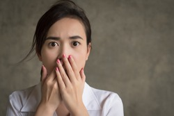 woman with shocking mood; portrait of shocked, stunned, fear, scared asian woman; asian 20s young adult woman model