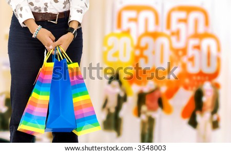 woman with shopping bags at a shopping mall