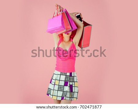 Woman with shopping bags. Fashion shopper posing on pink background. Holidays celebration concept. Sale and black friday. Girl wearing fashionable clothes. #702471877