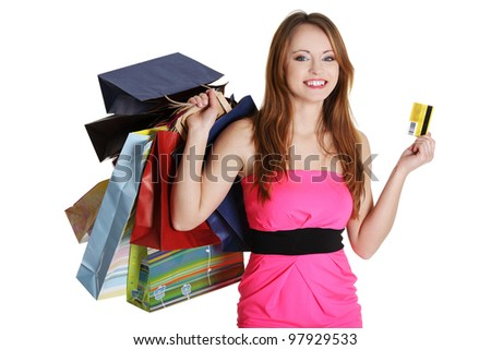 Woman with shopping bags holding credit card, isolated on white background