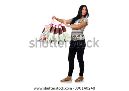 Woman with shopping bags isolated on white #390140248