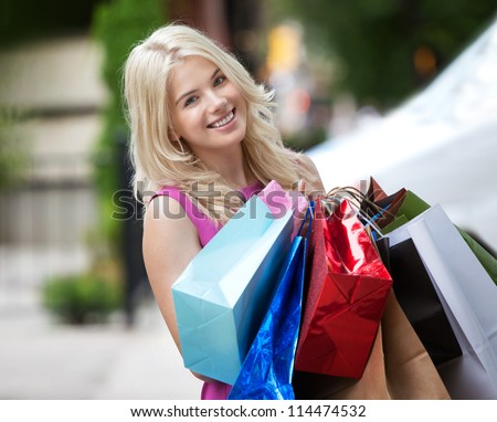 Woman with Shopping Bags, outdoors.